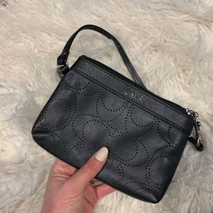 Black Coach wristlet perforated